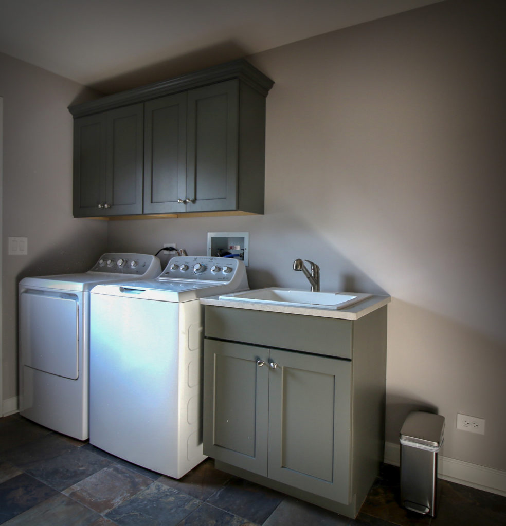 Laundry Room with Cabinetry and Slate Floor