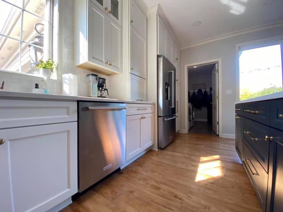 Warm Wood Floors Paired with White and Dark Grey (Iron Ore SW) cabinets