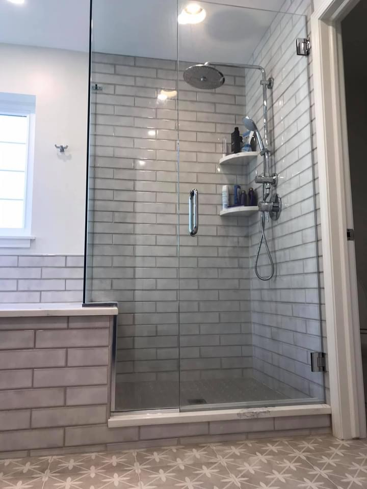 Custom Shower Enclosure with Chrome Grohe Plumbing Fixtures