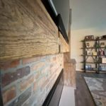 Vintage Brick Entrainment Wall Paired with Reclaimed Wood Mantle