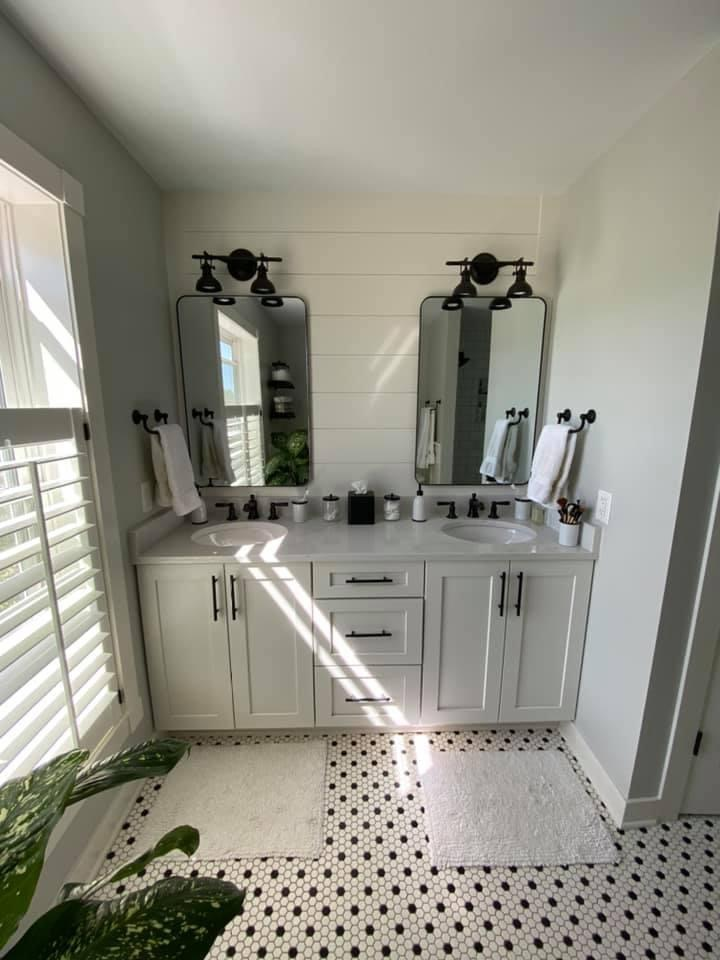 Shiplap Accent Wall with Vintage Inspired Lighting and Plumbing Fixtures